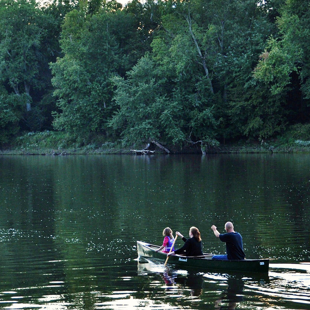 A family paddling a canoe on the Potomac River